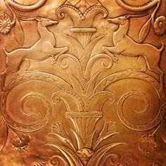 ornate brass elevator door