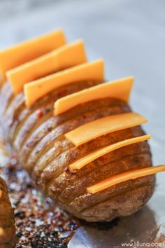 Cheesy Hasselback Potatoes stuffed with cheese, bacon and so much flavor. It's one of the yummiest ways to serve potatoes. Air Fryer Recipes Potatoes, Baked Potato Recipes, Gourmet Recipes, Cooking Recipes, Meal Recipes, Hassleback Potatoes, Food Dishes, Side Dishes, Dishes Recipes