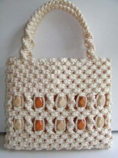 My mom took a macrame class back in the 1970s and made all of us a purse like this one with the beads