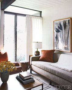 CALIFORNIA STYLE WITH AN ASIAN TWIST    In the den, a drawing by Edward Stanton hangs above a '50s sofa upholstered in a Hinson & Co. fabric; the cocktail table is by Paul McCobb, and the curtain is of an Irish linen.
