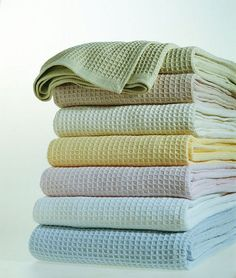 BLANKET: Sferra's Kingston Cotton Thermal Blanket - Softness, Warmth and Comfort - all in one! The classic waffle weave of Sferra's cotton thermal blanket is designed to shelter warmth, while its pure cotton offers dulcet softness and inviting comfort. Pre-shrunk so it stays generously sized to accommodate deep mattresses and comes in 7 soft pastels and neutrals. Made in Portugal. Machine wash.