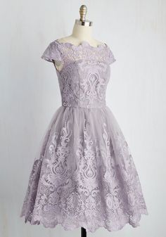 Make an unforgettable entrance in this decadently embroidered dress by Chi Chi London! With an ornate illusion neckline, intricate scalloped lace, and a full, tulle-lined skirt, this lavender frock exudes timeless feminine flair.