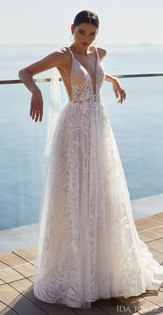 A-line lace wedding dress with straps and plunging v-neckline | Ida Torez Wedding Dresses 2021 Brave Glanze Collection - 01223-Tempting mouth- Belle The Magazine | See more gorgeous bridal gowns by clicking on the photo