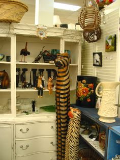 carved wooden cats - awesome! Come see them this week at Treasure Trove, Hudson, Fl.