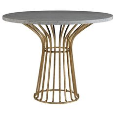 """Our iconic spin on mid-century design is getting a decadent new look. We've taken our most-loved cocktail table and made it a 38"""" round dining surface, perfect for an eat-in kitchen or apartment living. Gold and high-polished white marble offer a look that's fresh from the runway.    Finish: Antique Gold, White Marble   Materials: Stone, Metal with applied Gold Leaf."""
