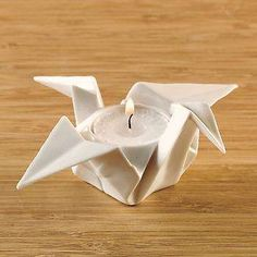 Beautiful votive candle holder that looks like an origami crane, but it's made of white porcelain