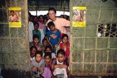 "UNICEF Goodwill Ambassador Audrey Hepburn joins students at the doorway of their classroom.   In 1989, UNICEF Goodwill Ambassador Audrey Hepburn visited Bangladesh to review UNICEF programmes there. On concluding her visit, Ms. Hepburn said, ""The economy of this young, only 18-year-old nation may have been impoverished by war, famine and floods, but it has untold wealth in the resilience and resourcefulness of its bright, active, talented people.""  © UNICEF/John Isaac  http://www.unicef.org"