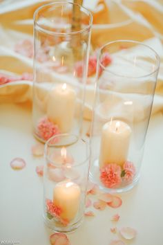 White candles, pink chresantemum