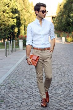 Male model in shades wearing a white long sleeve shirt unbuttoned and worn v-neck style with sleeves folded up to elbow length. Navy blue slim fit pants worn with a brown woven belt. Reddish brown leather shoes with tarnished pin buckles attached on it. (Vanessa Ng FMM1B1)