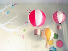 Cute idea to turn the lanterns into hot air balloons. 15 DIY Ideas for the Ultimate Oz Party
