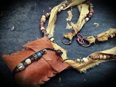 Tribal gypsy leather amulet necklace with beads and by quisnam, Textile Jewelry, Fabric Jewelry, Jewellery, Beaded Purses, Beaded Bags, Leather Necklace, Leather Jewelry, Tribal Necklace, Leather Pouch