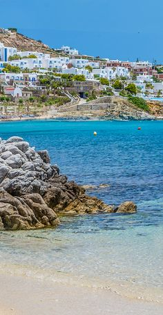 Stop for photos at the chic and stylish Agios Ioannis Beach. This small beach in Mykonos, Greece boasts soft, white sand and crystal clear blue waters.