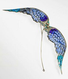 Enguerrand Suau de la Croix hair pin, c. 1900. Enamel plique-à-jour cabochons depict two wings | Musée d'Orsay, Paris, France