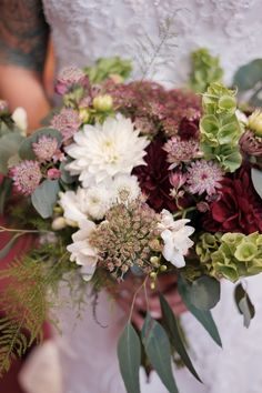 Bells of Ireland, burgundy dahlias, astrantia and queen anne's lace with lots of Irish details.