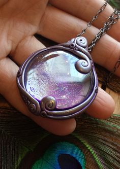 Scrying (also called seeing or peeping) is the practice of looking into a translucent ball or other material with the belief that things can be Polymer clay crystal pendant