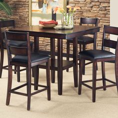 """The Canyon collection is clean and casual with a dark merlot finish, soft sanded corners and dark brown edge burnishing. Sit comfortably around a 40"""" square counter height table on counter height stools with beautiful slat backs and cushioned slip seats.Features:Table: Counter-heightDark brown bu..."""