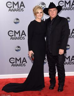 Coordinating couple: Garth Brooks and wife Trisha Yearwood at the 48th annual CMA Awards o...