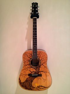 Art guitar. Pyrography. I strip the guitar top and wood burn the design and the re varnish the top to a high gloss finish.