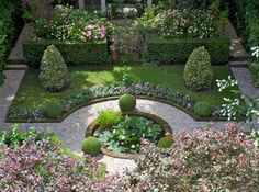 small formal garden space . water lily pond . private gardens at Museum Geelvinck, Amsterdam