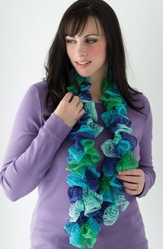 Follow this free crochet pattern to create this light and lacy summer scarf. Shown in Red Heart Sashay (1959) Twist.