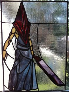 Pyramid Head in stained glass  http://www.facebook.com/groups/195025377311936/permalink/195055290642278/