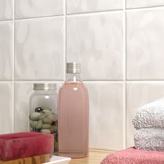 Our Glossy Bumpy White tiles are one of our best sellers - the simple tiles have a textured surface which adds interest to bathroom walls and kitchen splashbacks.