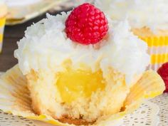 Fluffy lemon frosting and a pocket of lemon filling makes these Lemon Coconut Cupcakes a bright and refreshing spring dessert! A great party dessert! Lemon Dessert Recipes, Lemon Recipes, Cupcake Recipes, Baking Recipes, Sweet Recipes, Cupcake Cakes, Cup Cakes, Coconut Recipes, Fast Recipes