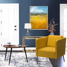 Mustard is a colour that adds depth, warmth and a ray of brightness to an interior colour scheme, the trick is to use it sparingly highlighted through artwork and accent furniture pieces. Gold tones work well with mustard and similar tones of blue to create intensity and drama, as shown in this image below.