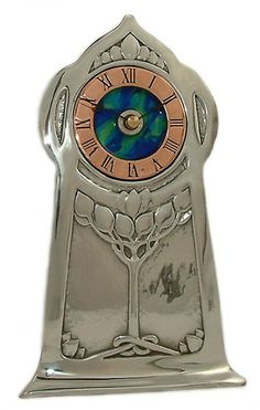 Reproduction Archibald Knox Clock - Polished Pewter front decorated with honesty leaves. Features enameled blue panel and copper dial - £120.00 (sale price)