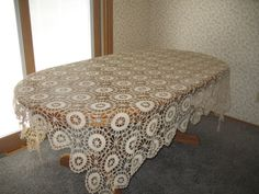 Crocheted tablecloth (vintage) and matching doilies    Free Shipping!    Lovely Christmas gift!    This beautifully hand crocheted tablecloth