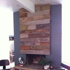 Reclaimed wood on our fireplace