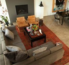 living-rooms-gray-red-art-decoration-chairs-coffee-tables-concrete-floors-cushions