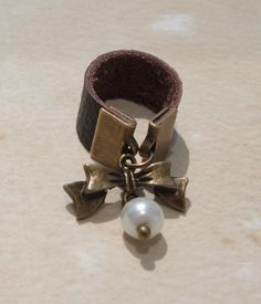 Bow and Pearl Leather Ring Sz 4-5. $8.00, via Etsy.