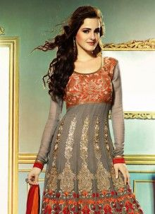 This long anarkali salwar kameez with heavy embroidery on the neck portion as well as the bottom portion of the kameez also looks preety heavy because of the color combination of grey and orange, maroon. Anarkali Churidar, Anarkali Dress, Salwar Kameez, Anarkali Suits, Long Anarkali, Punjabi Suits, Bollywood Outfits, Pakistani Outfits, Indian Outfits