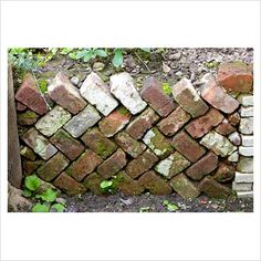 german garden, recycled retaining brick wall - use along my west walkway