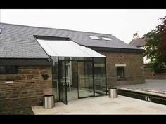 a large glass entrance Entrance, Glass, Outdoor Decor, Home Decor, Entryway, Decoration Home, Drinkware, Room Decor, Door Entry