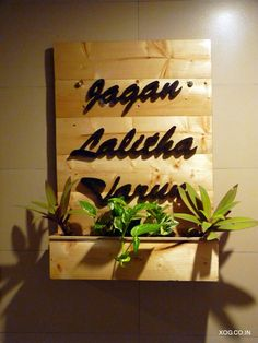 Name plate planter by XOG custom made with house numbers, family names or a greeting of your choice. These living name plates are sure to warm up the entrance of your abode and excite visitors. Contact us at: xanaduorganicgardens@gmail.com or +91 888 455 5869 to know more. Wooden Name Plates, Door Name Plates, Name Plates For Home, Wooden Name Signs, Plates On Wall, Plate Wall, Name Plate Design, Name Design, Bamboo House Design