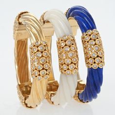 Van Cleef & Arpels Set of 3 Bangle Bracelets in Diamond and Gold, White Coral and Lapis Lazuli.  Available exclusively at Macklowe Gallery.