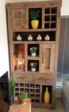 We love to show the ideas which serve for more than one purpose due to which this cabinet plan is here in this list. You can see for how many purposes it can be used; there are decorative items as well as the bottles fitted in it.