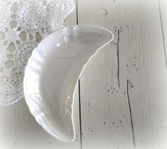 Farmhouse chic white Ironstone Crescent Dish (bone dish).  Beautiful ironstone bone dish with a raised leaf pattern and scalloped edges.  Lovely condition with no chips or cracks.  English Ironstone made by Wilkinson.  Measures approximately 6 1/2 inches by 3 inches.  Use for rings, earrings, trinkets or soaps.  If you like this and want to see more please visit my shop at www.etsy.com/shop/SeasideRoseCreations
