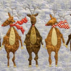 """Close-up, """"Santa's Christmas Card"""" by Sharon Gregorczyk, New Braunfels Area Quilt Guild. The pattern is by Pieces from my Heart"""