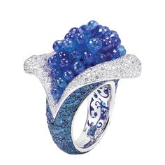 Ring | de Grisogono Designs. White gold ring with 37 briolette-cut blue sapphires, 318 blue sapphires, and 398 white diamonds.