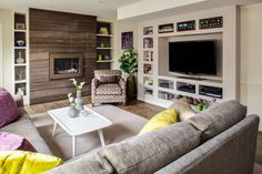 A lower level rec. room got a major makeover, a built-in #media #center adds function and fun #fabrics add pizazz.  #INTERIOR #DESIGN: A. Houck Designs, Inc.