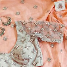 Beautiful saree n backless choli blouse with embroidery, worn with exquisite bali earrings. is in pastel peach, in cream. Saree Blouse Neck Designs, Saree Blouse Patterns, Bridal Blouse Designs, Stylish Blouse Design, Organza, Stylish Sarees, Saree Dress, Lehenga Blouse, Indian Designer Outfits