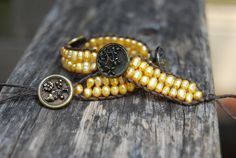 Wrapped Leather Bracelet with Golden Freshwater Pearls & Vintage Buttons - Yellow Gold Pearl, Boho, Stackable, Wrap, Beach. $45.00, via Etsy.