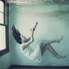This picture of a woman under water represents the event of Ophelia drowning. The woman is just laying there under the water, not trying to save herself or stop from drowning, much like Ophelia does towards the end of the play.