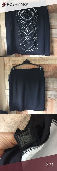 "WORTHINGTON Skirt sz 8 Black skirt with white cut out pattern on the front.  Size 8, just over 15"" across the waist x 21"" long.  6.5"" zipper and eye closure in back, no slit.  93% poly 7% spandex.  Never worn, tags attached. Worthington Skirts Midi"