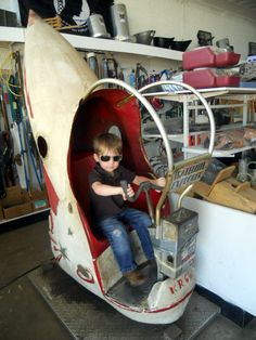 1950's Rocket Ride.....still works for only a dime! Grandson Matt......remind you of Top Gun? lol