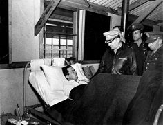 General Douglas MacArthur visits a serviceman in hospital by State Library of Queensland, Australia, via Flickr