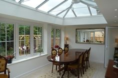 Orangery dining room extension, Norfolk, by Morton WIndows & Conservatories Conservatory Design, Extensions, Dining Room, Windows, Table, Furniture, Home Decor, Decoration Home, Room Decor